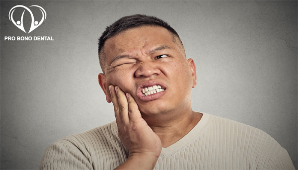 Man with tooth ache  | Pro Bono Dental