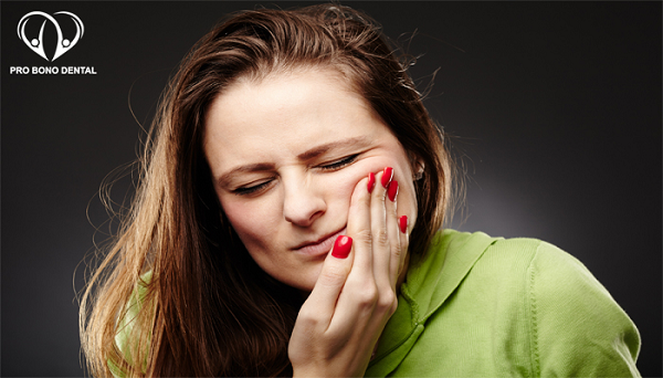 Woman with Tooth Ache | Pro Bono Dental